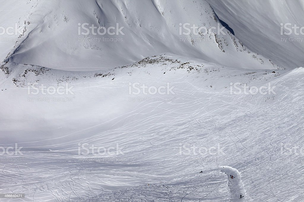 Snowboarders and skiers on off-piste slope with trace stock photo