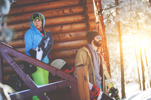 Snowboarders going to ski trace