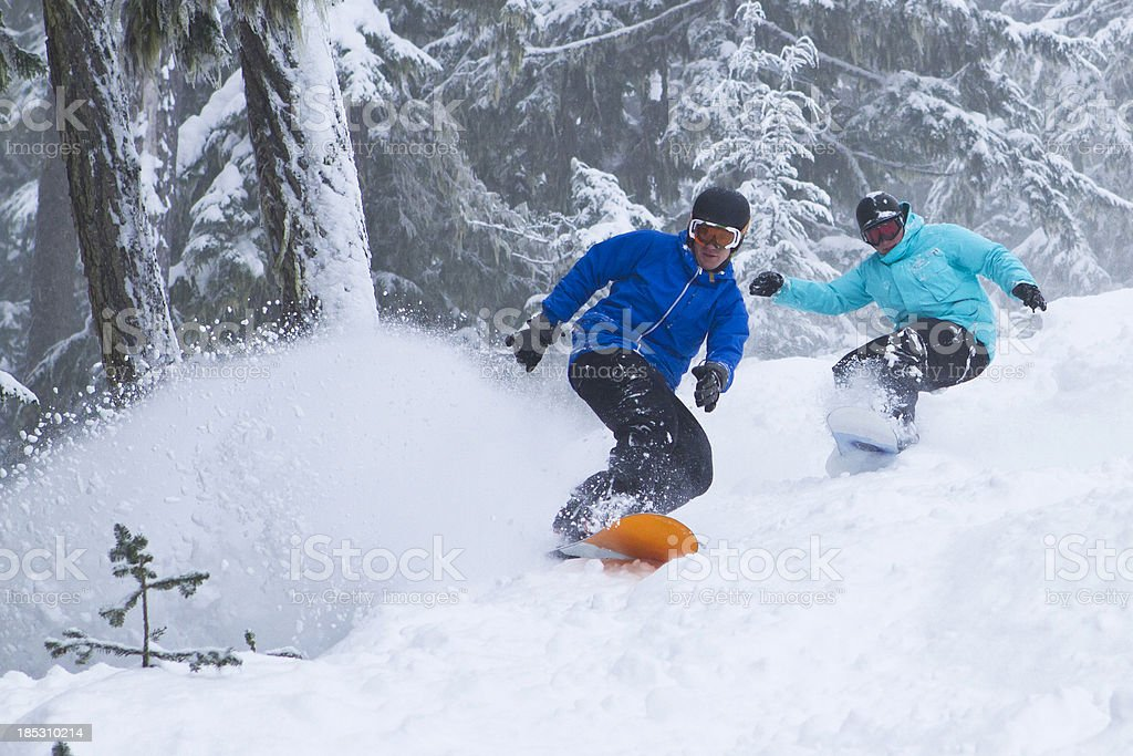 Snowboarders in deep powder. royalty-free stock photo
