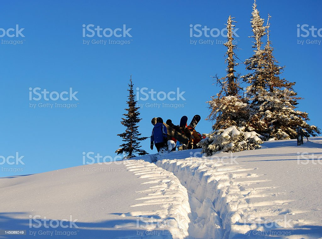Snowboarders on the hill royalty-free stock photo