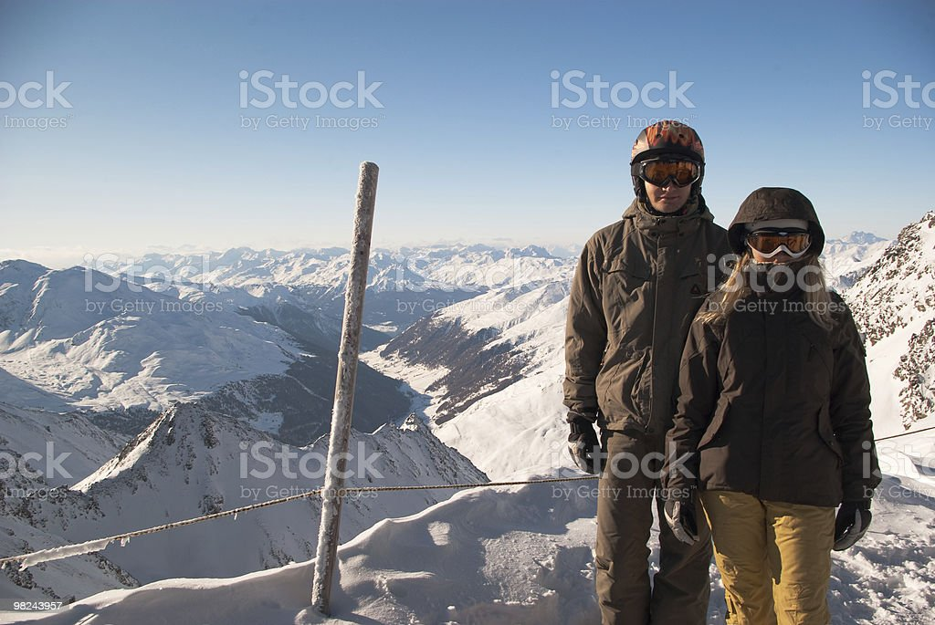 Snowboarders on top of the mountain royalty-free stock photo