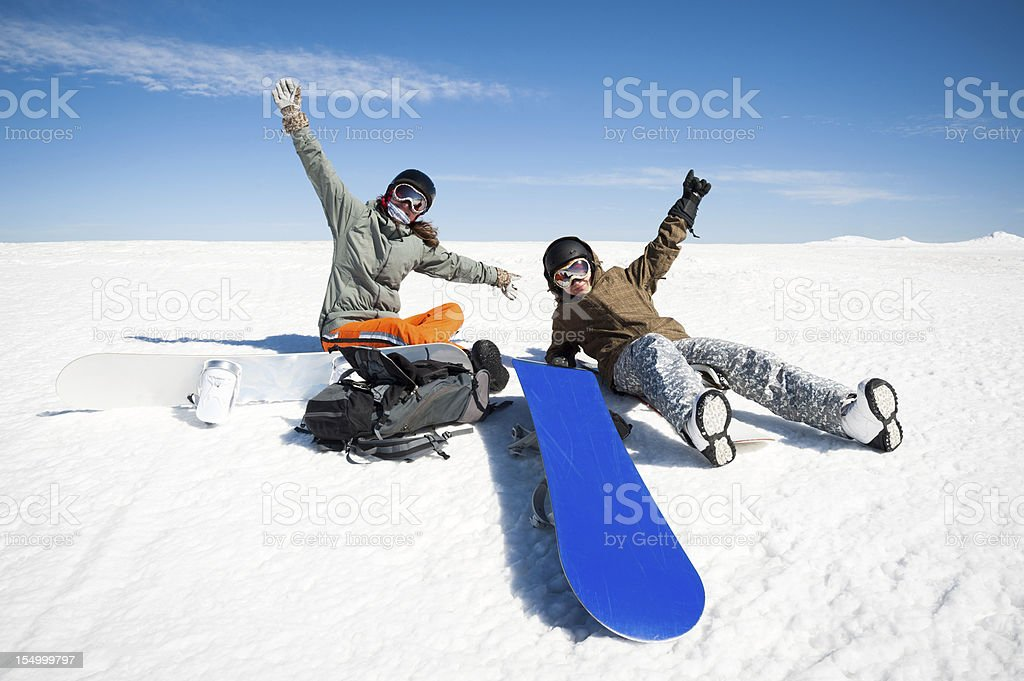 two positive snowboarder in the mountains. People - snowboard team