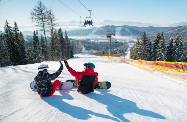 Snowboarders sit on the top of the ski slope under the ski lift lets picture id848069208?b=1&k=6&m=848069208&s=612x612&w=0&h=2nzj4jcjbha6boo2eek33gd jsurqwckh0v3xn730nm=