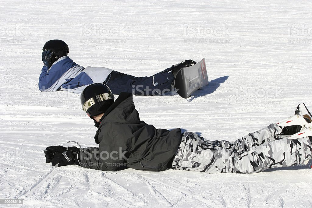 Snowboarders taking a rest royalty-free stock photo