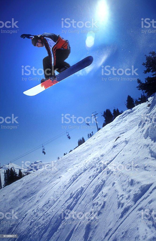 Snowboarden im Sonnenschein Lizenzfreies stock-foto