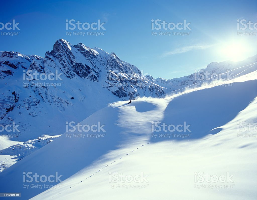 Snowboarding in the alps stock photo