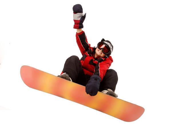 Snowboarding kid stock photo