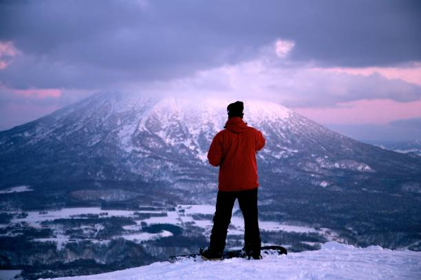 Snowboarding on Dusk with Mt. Yotei View stock photo