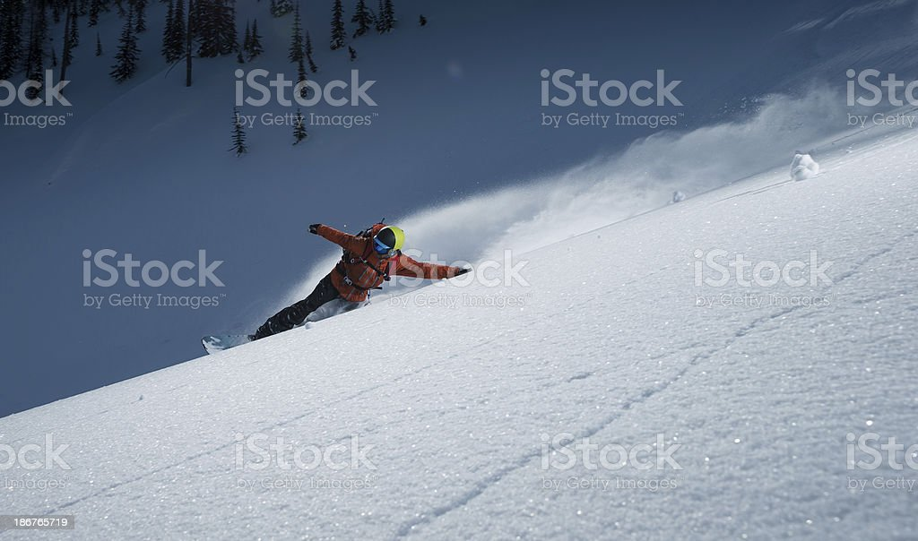 snowboarding powder stock photo