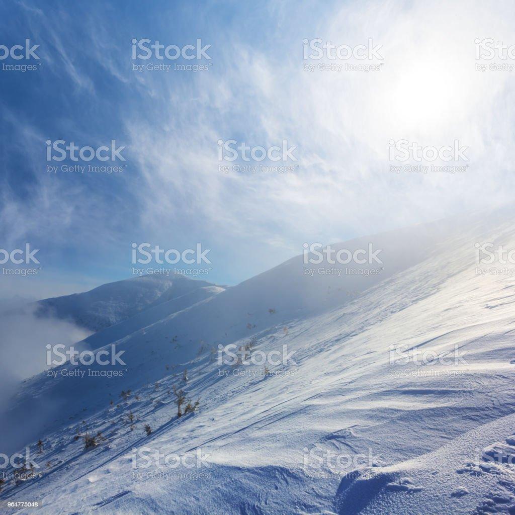 snowbound mountain slope  under a sparkle sun royalty-free stock photo