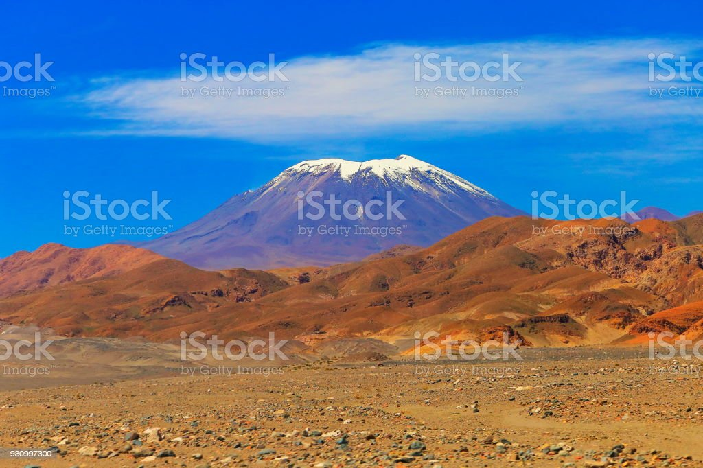 Snowcapped active Lascar volcano, Atacama Desert Volcanic landscape –  Chile stock photo