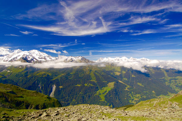 Snow-Capped Alpine Summits in the Clouds stock photo