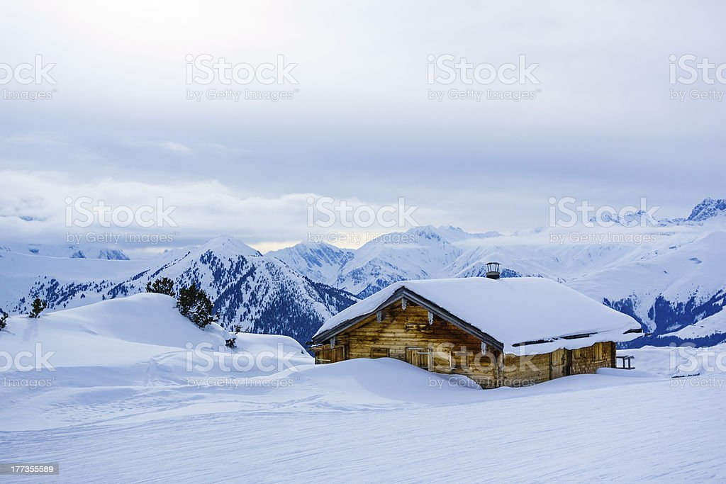 Snowcapped cottage in winter royalty-free stock photo