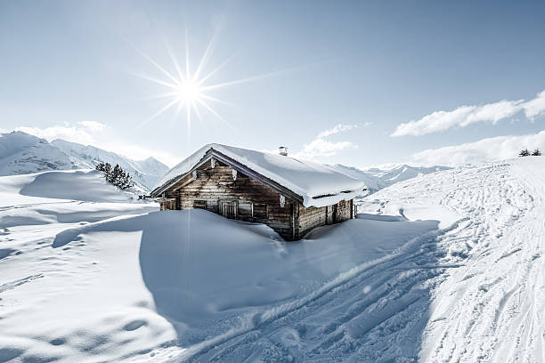 Snowcapped cottage in winter Snowcapped cottage in winter sunny day. chalet stock pictures, royalty-free photos & images