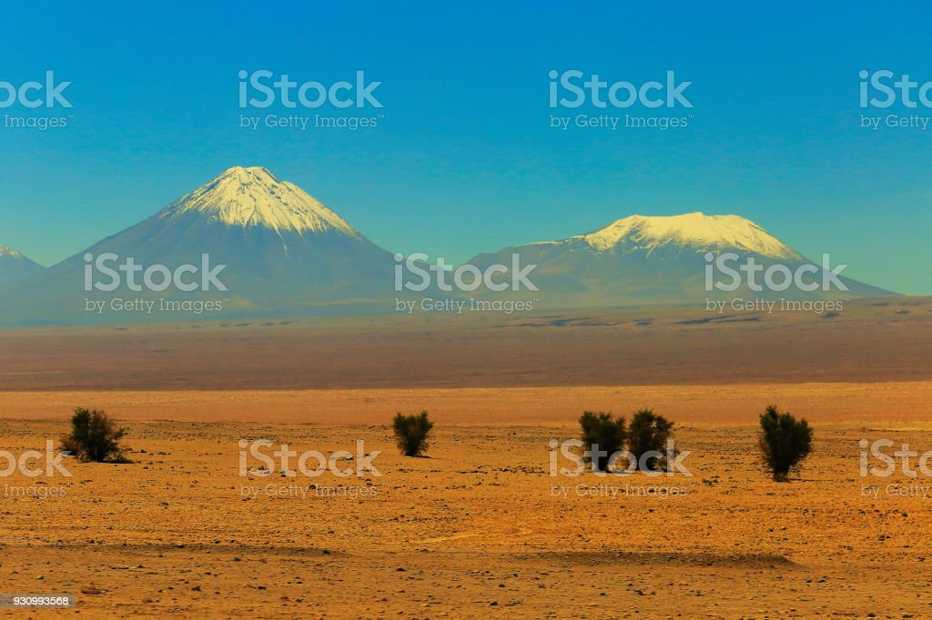 Snowcapped Licancabur and Juriques volcanoes at sunset, Atacama Desert –  Chile stock photo