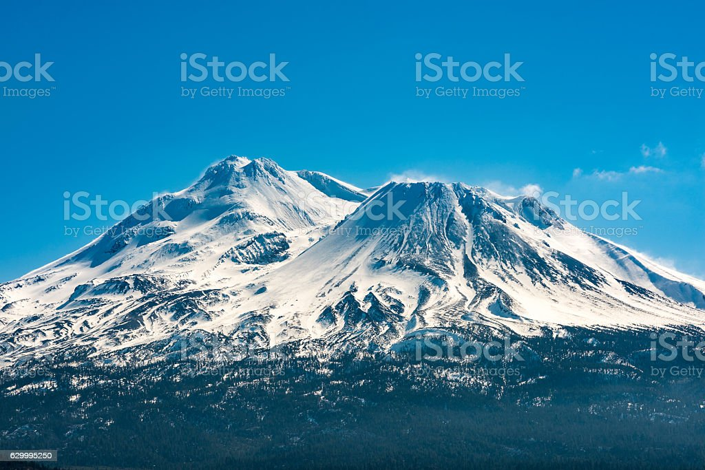 Snowcapped Mount Shasta volcano during winter blue closeup stock photo