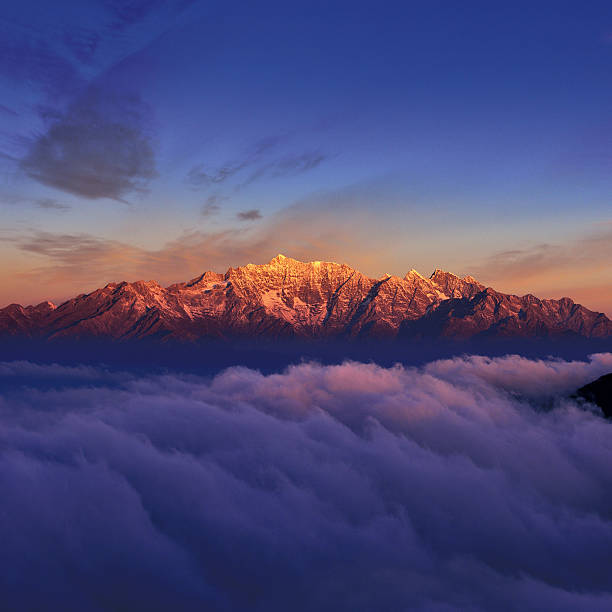 Snowcapped Mountain at Sunrise - Photo