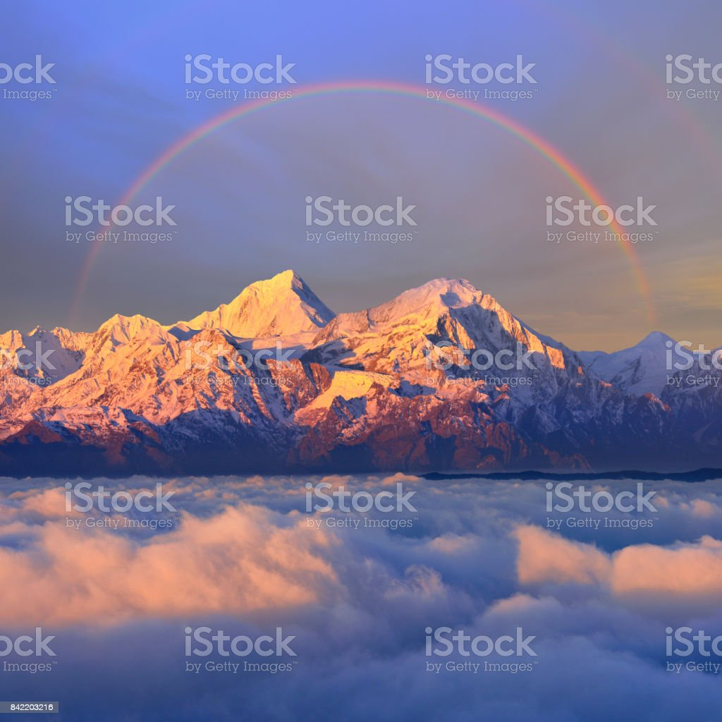 Snowcapped Mountain at Sunrise (Cattle Back Mountain) stock photo