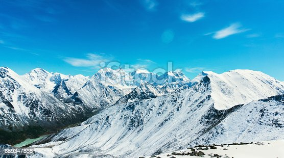 istock Snow-capped mountains against the blue sky in Altai Republic 689347858