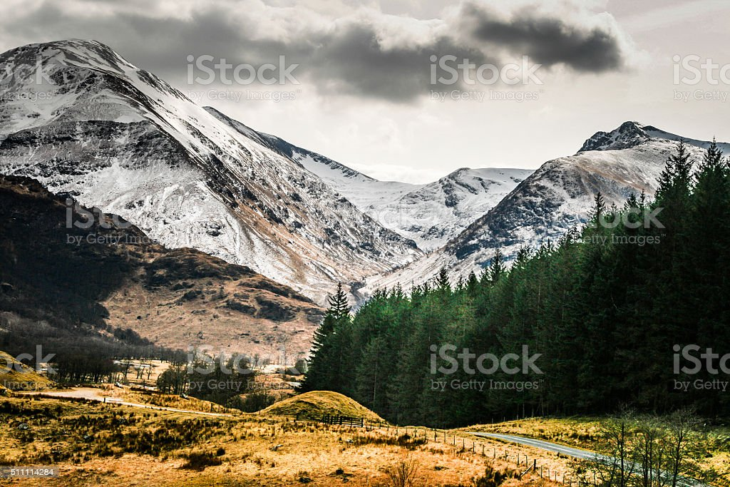 Snowcapped Mountains and Forest Road, Glen Nevis, Scotland, UK stock photo