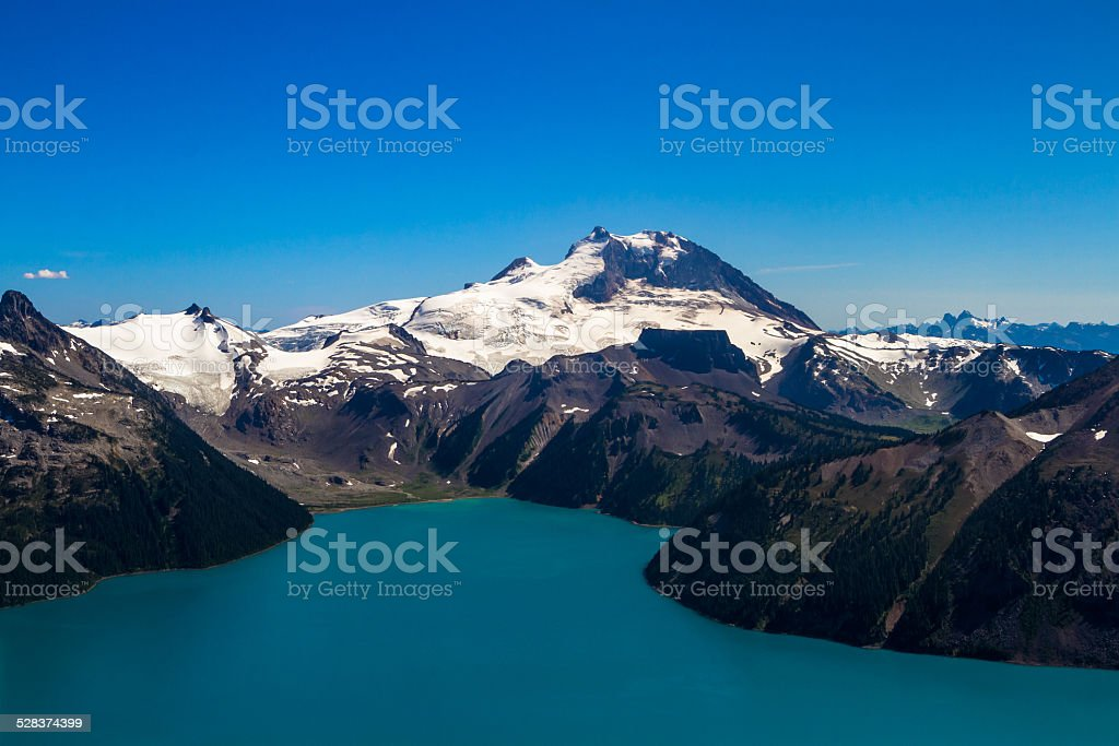 Snow-Capped Mountains and Lake in British Columbia, Canada stock photo