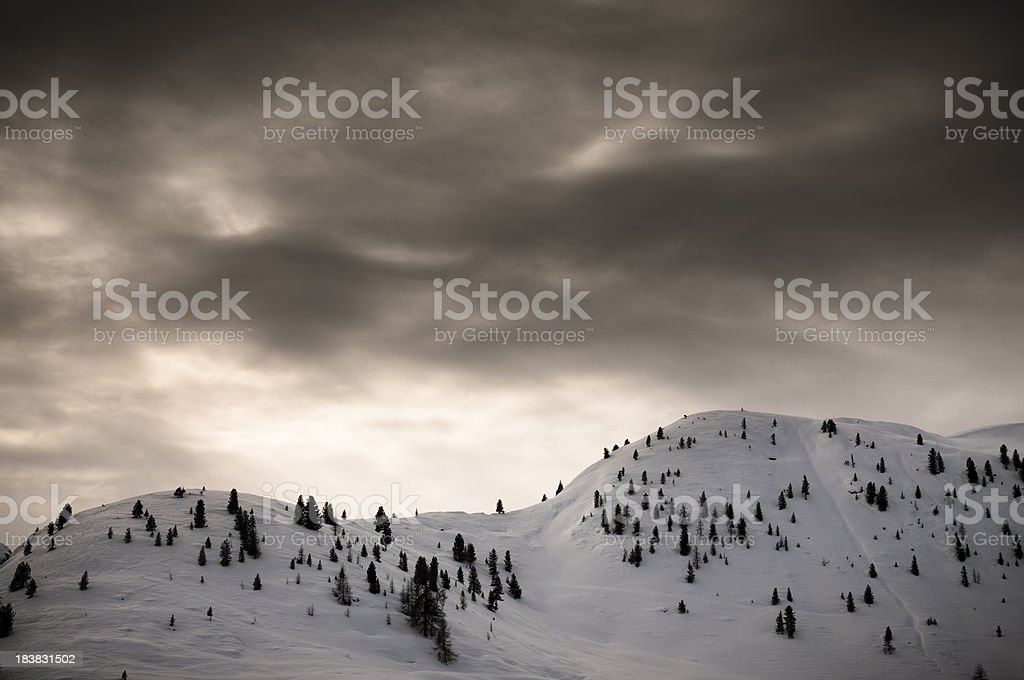 Snow-capped mountains with dramatic sky royalty-free stock photo