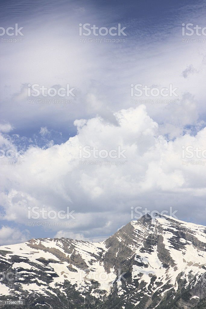 Snowcapped Rocky Mountains Dramatic Cloudscape royalty-free stock photo