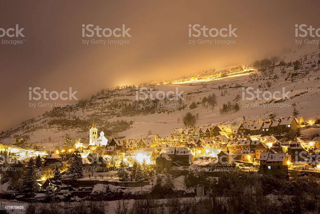 Snowcapped  village in the mountains stock photo