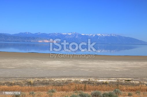 Reflections of the Wasatch Mountain range seen at Antelope Island, Utah