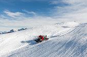 Snowcat groomer working on snow track