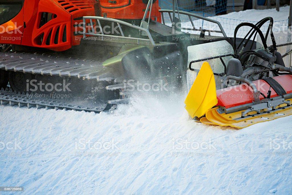 Snowcat groomer working  Preparing the ski slopes stock photo