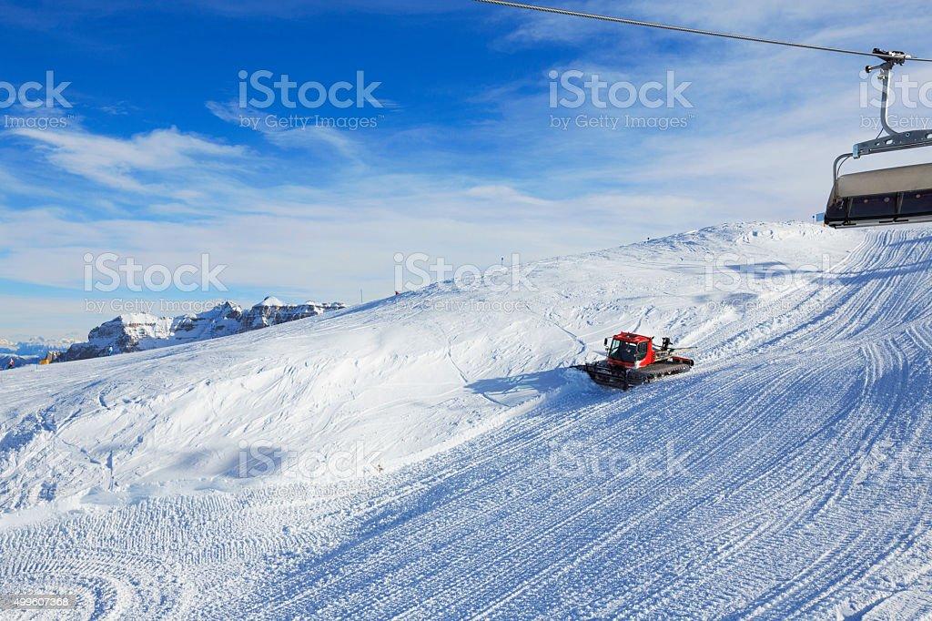 Snowcat groomer working  Preparing the ski slopes Ski resort stock photo