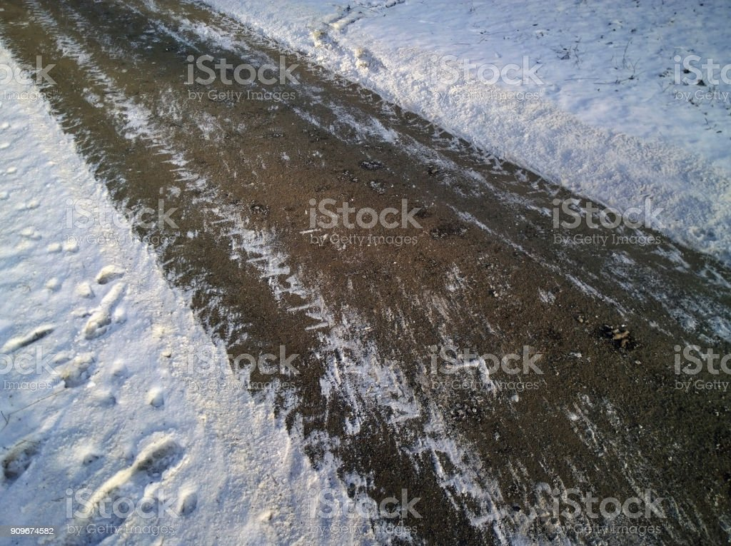 Snow-cleared pavement in winter. Selective focus. stock photo