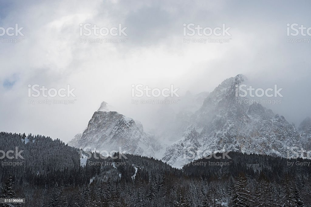 Snowclouds draw on the cliffs of the Wetterstein mountains stock photo