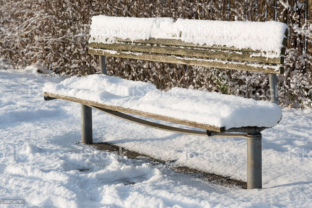 Snowcovered bench. Imprint from guest stock photo