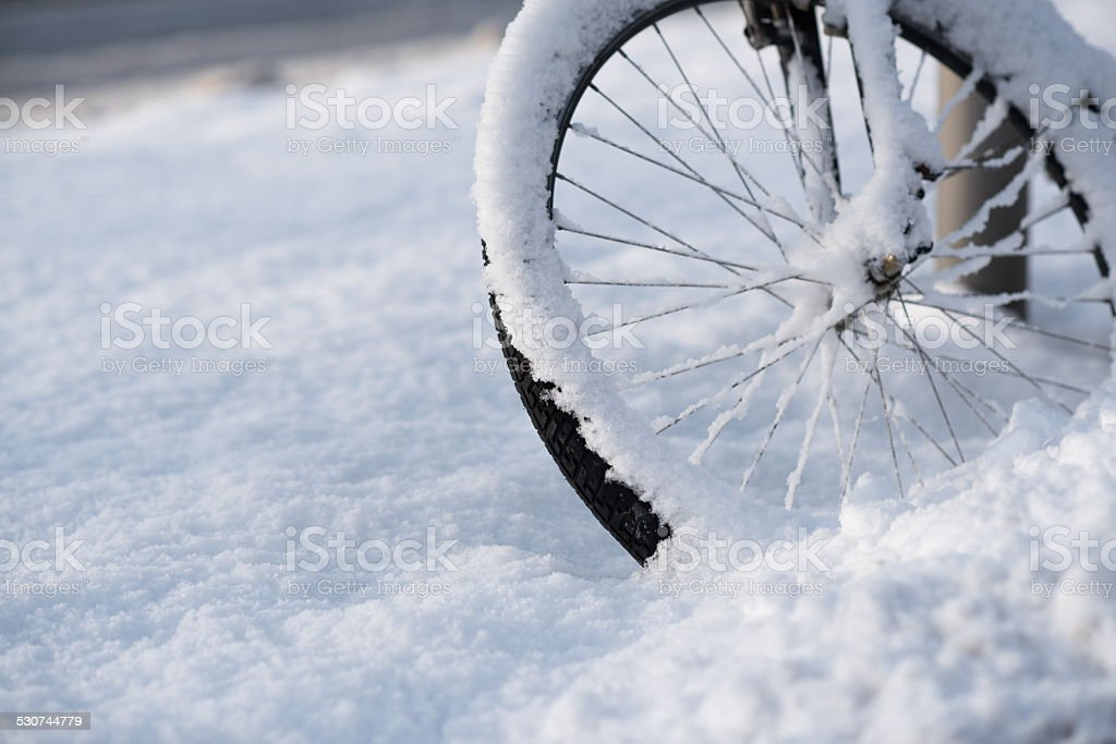snowcovered bicycle wheel stock photo