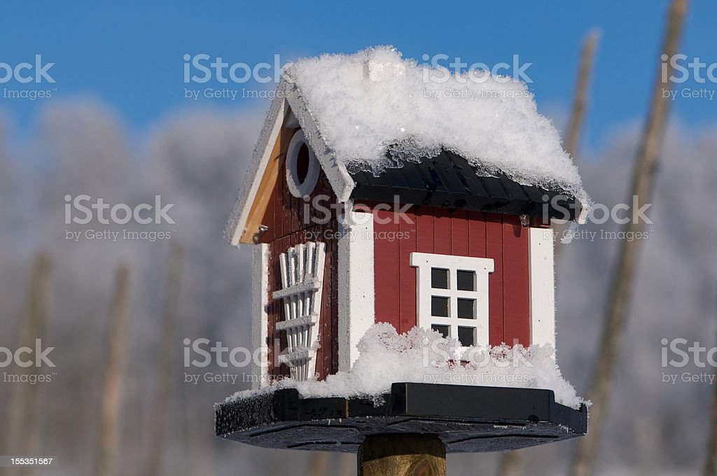 Snowcovered Bird House Dalarna style in Winter royalty-free stock photo