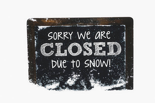 snow-covered chalkboard reading closed due to snow. winter weather concepts. - closed stock photos and pictures