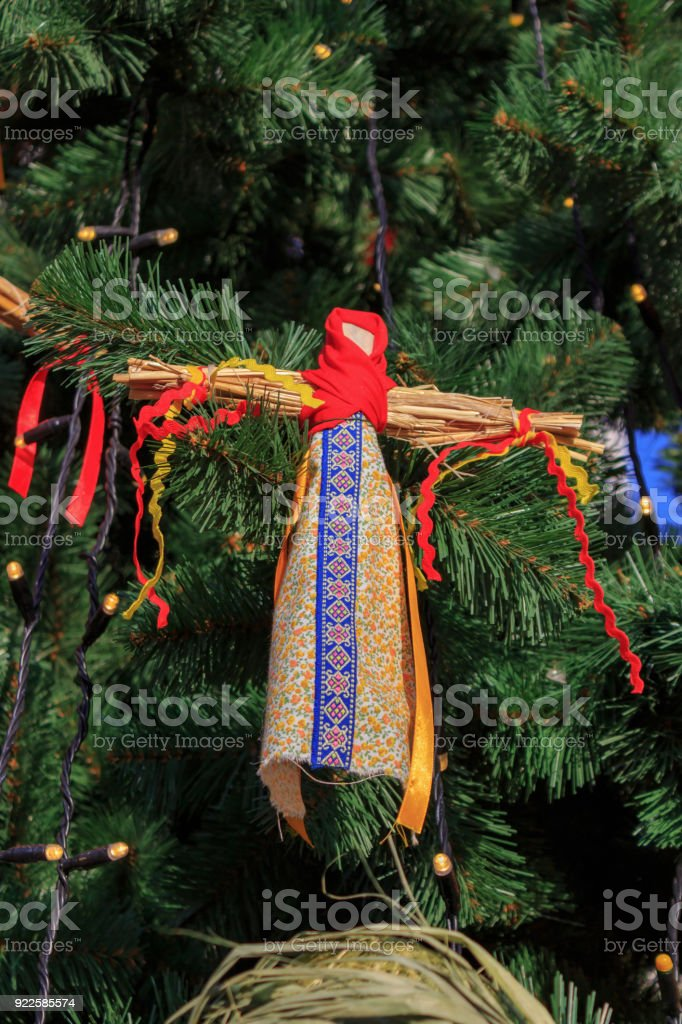 Snow-covered ?hristmas tree decorated with rag toys stock photo