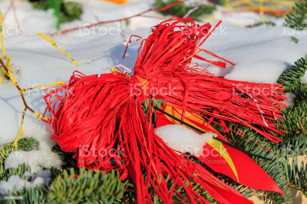 Snow-covered ?hristmas tree decorated with straw toys stock photo