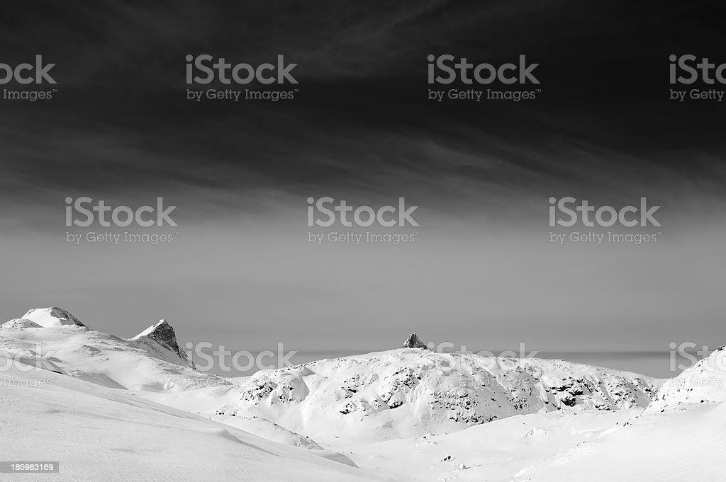 Snow-covered mountain peaks in Jotunheimen National Park stock photo