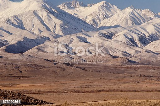 Snow-covered peaks of the Sierra Nevada Mountains and Owens Valley in winter near Bishop California