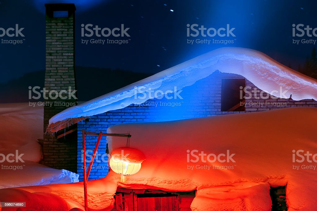 Snow-covered red lantern in winter royalty-free stock photo