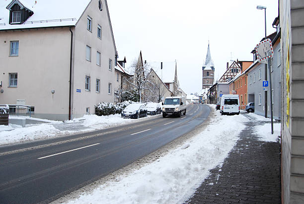 Snow-covered residential street daily in with some cars Erlangen,  Germany -DECEMBER 18, 2010: Snow-covered residential street daily in with some cars  on December 18.2010 in Erlangen, Germany  as editorial erlangen stock pictures, royalty-free photos & images