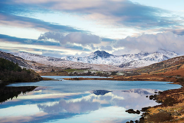 Snowdonia mountains Wales, Snowdon, 11 May, 2015 : Snowy Snowdonia mountains in winter . wales stock pictures, royalty-free photos & images