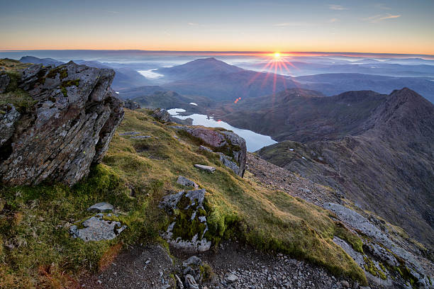 Snowdonia National Park An amazing sunrise over the Snowdonia national park as view from the summit of Snowdon on a cold Octobers morning.  wales stock pictures, royalty-free photos & images