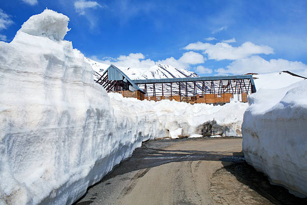 Snowdrift at the Leh - Manali Highway in Indian Himalayas stock photo