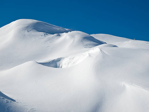 snowdrift - snow pile stock photos and pictures