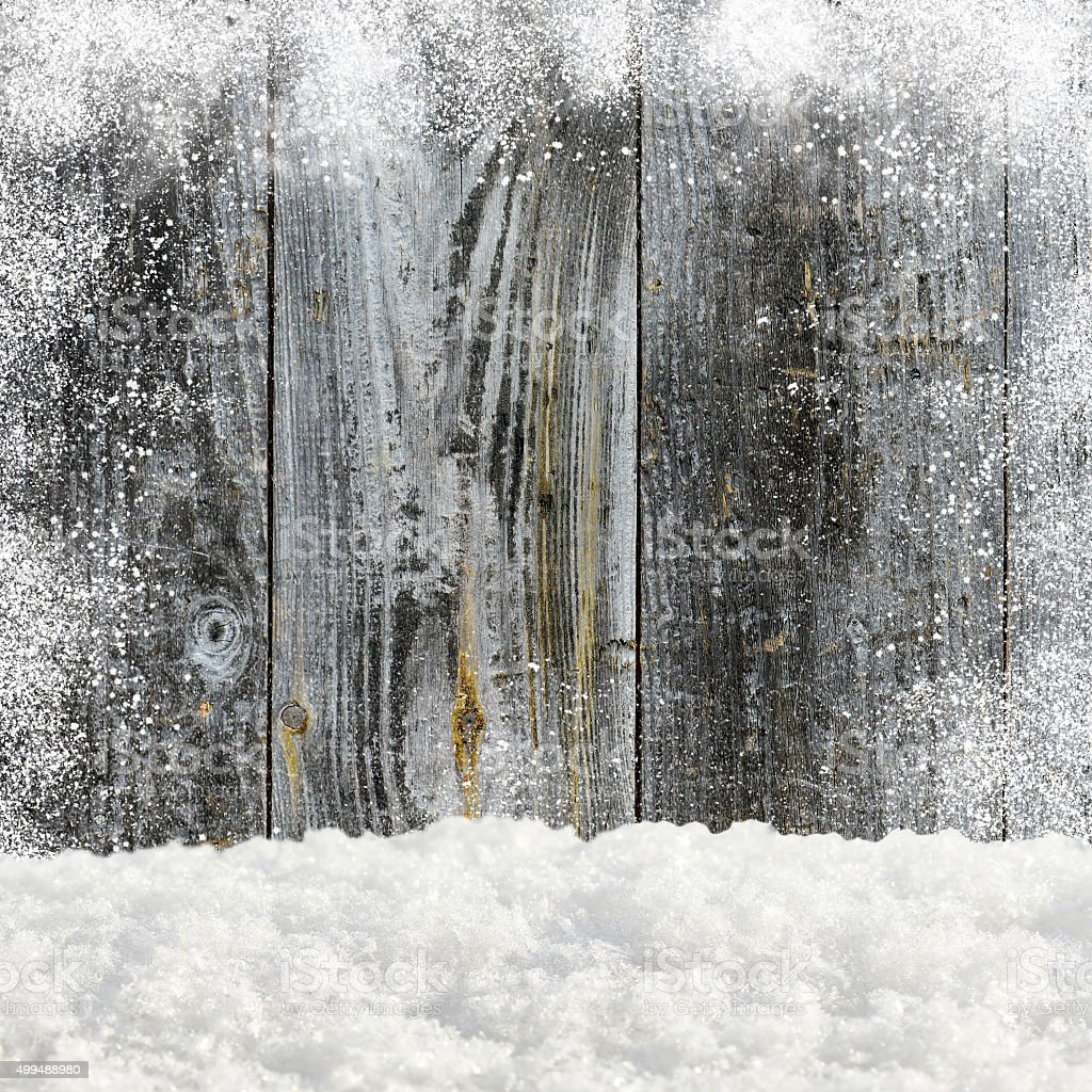 Snowdrifts. In the background old wooden wall with blank space stock photo