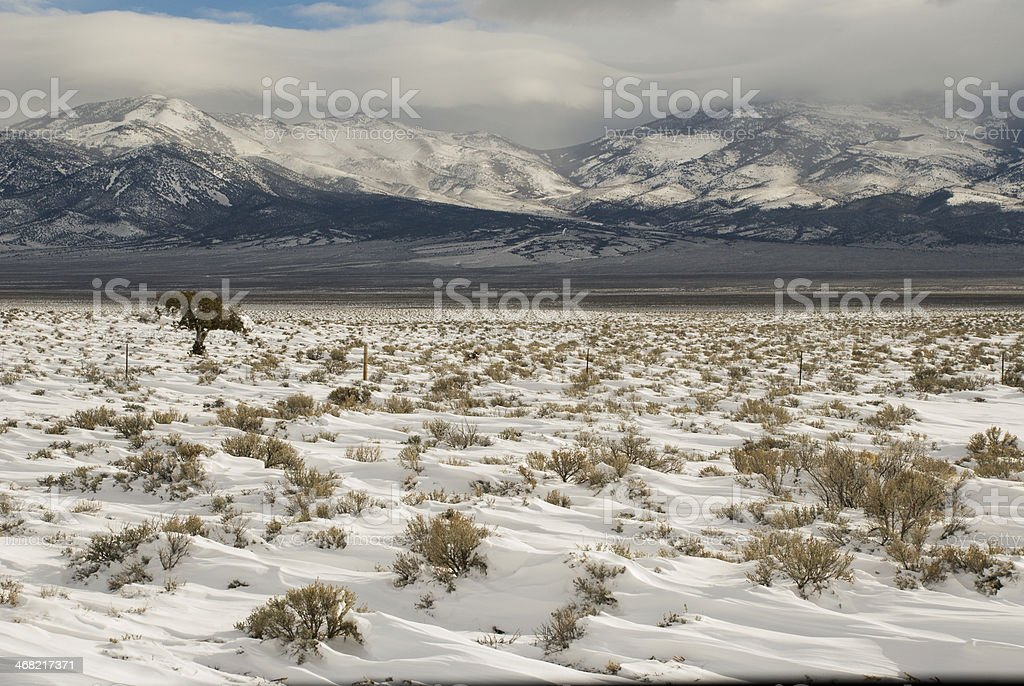 Snowdrifts on Great Basin Landscape near Baker Nevada stock photo